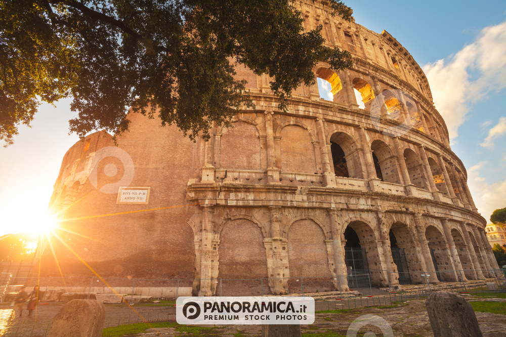 A view from below of Colosseum with stunning backlight, Rome, Italy