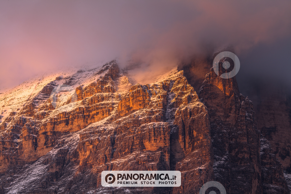 Alpenglow and clouds highlighting Tofana di Rozes, Cortina d'Ampezzo, Dolomites, Veneto, Italy