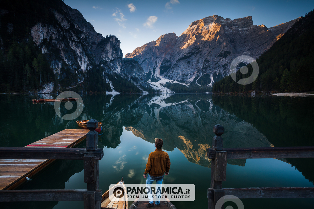 Man standing on the stairs to Lago di Braies, Pragser Wildsee, Dolomites, South Tyrol, Italy
